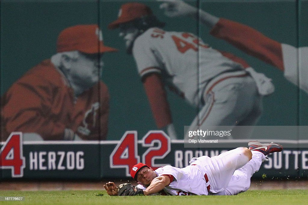 <a gi-track='captionPersonalityLinkClicked' href=/galleries/search?phrase=Matt+Holliday&family=editorial&specificpeople=207017 ng-click='$event.stopPropagation()'>Matt Holliday</a> #7 of the St. Louis Cardinals fails to catch a fly ball hit by <a gi-track='captionPersonalityLinkClicked' href=/galleries/search?phrase=Joey+Votto&family=editorial&specificpeople=759319 ng-click='$event.stopPropagation()'>Joey Votto</a> #19 of the Cincinnati Reds in the eighth inning at Busch Stadium on April 29, 2013 in St. Louis, Missouri. The Reds beat the Cardinals 2-1.