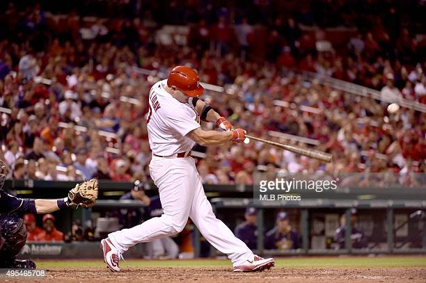 Matt Holliday of the St Louis Cardinals gets a base hit for his 45th consecutive game onbase streak during an MLB game against the Milwaukee Brewers...