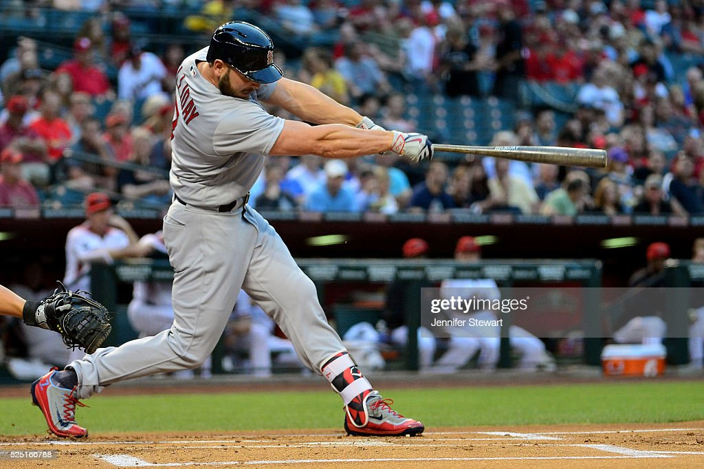 Matt Holliday #7 of the St. Louis Cardinals hits a ball resulting in a run scored on a fielding error in the first inning against the Arizona Diamondbacks at Chase Field on April 27, 2016 in Phoenix, Arizona.