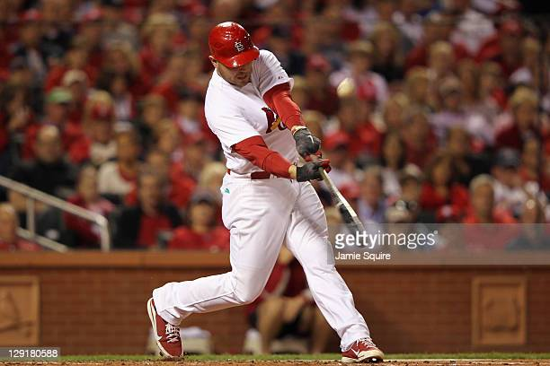 Matt Holliday of the St Louis Cardinals hits a solo home run in the bopttom of the second inning against the Milwaukee Brewers during Game 4 of the...