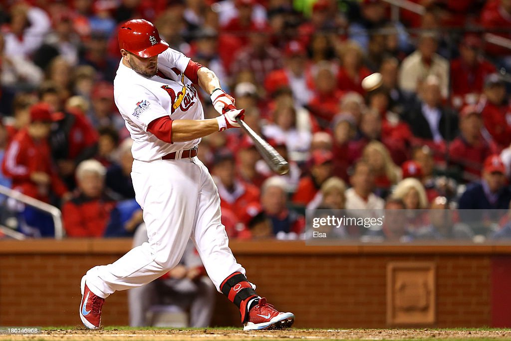 Matt Holliday #7 of the St. Louis Cardinals hits a solo home run in the fourth inning against the Boston Red Sox during Game Five of the 2013 World Series at Busch Stadium on October 28, 2013 in St Louis, Missouri.