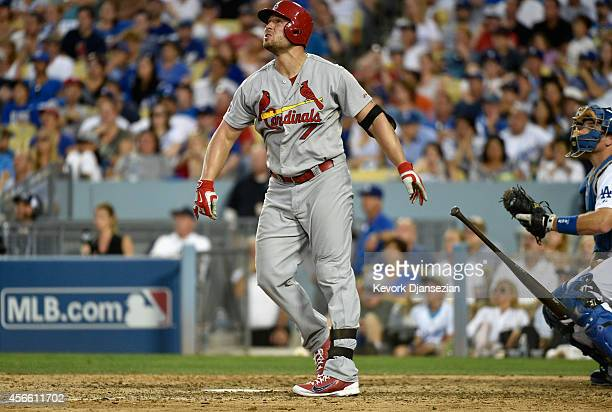 Matt Holliday of the St Louis Cardinals hits a three run homerun in the seventh inning during Game One of the National League Division Series at...