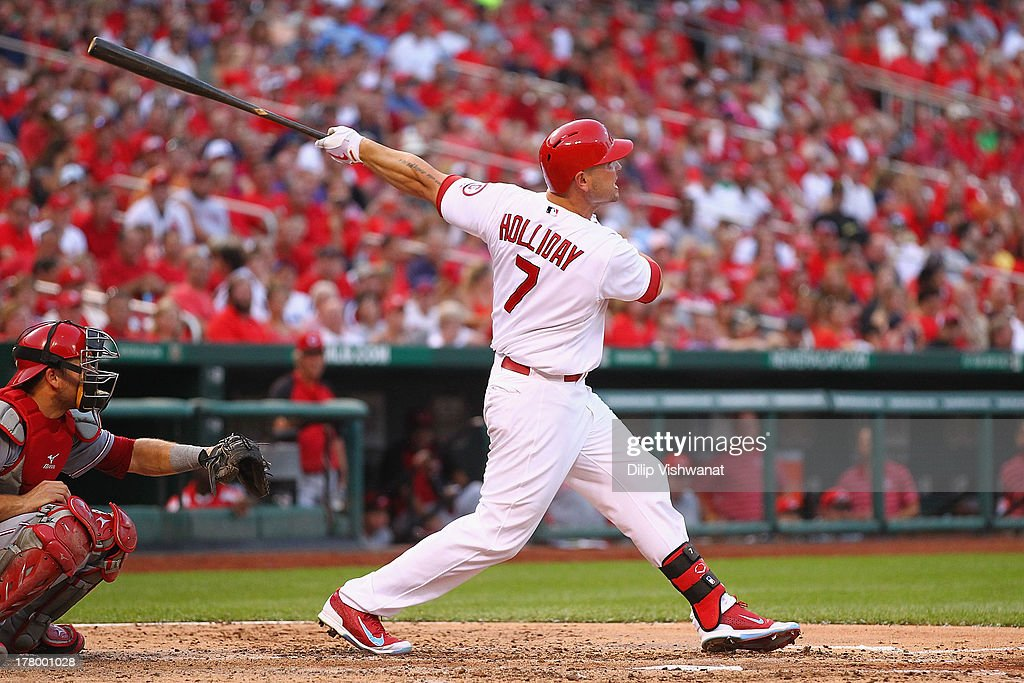 <a gi-track='captionPersonalityLinkClicked' href=/galleries/search?phrase=Matt+Holliday&family=editorial&specificpeople=207017 ng-click='$event.stopPropagation()'>Matt Holliday</a> #7 of the St. Louis Cardinals hits a three-run home run off of starter Mike Leake #44 of the Cincinnati Reds in the third inning at Busch Stadium on August 26, 2013 in St. Louis, Missouri.