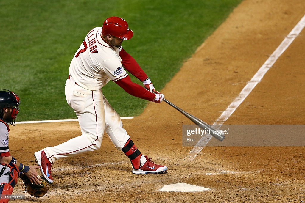 Matt Holliday #7 of the St. Louis Cardinals hits a two RBI double in the seventh inning against the Boston Red Sox during Game Three of the 2013 World Series at Busch Stadium on October 26, 2013 in St Louis, Missouri.