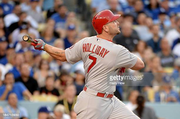 Matt Holliday of the St Louis Cardinals hits a tworun home run in the third inning against the Los Angeles Dodgers in Game Four of the National...