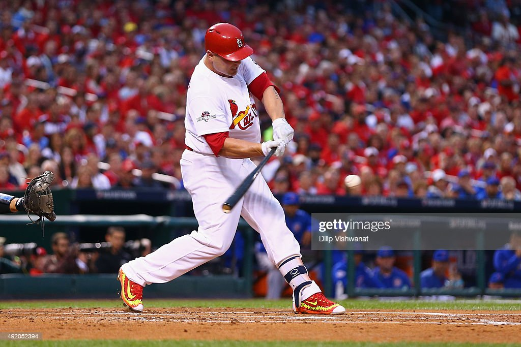 Matt Holliday #7 of the St. Louis Cardinals hits an RBI single in the first inning against the Chicago Cubs during game one of the National League Division Series at Busch Stadium on October 9, 2015 in St Louis, Missouri.