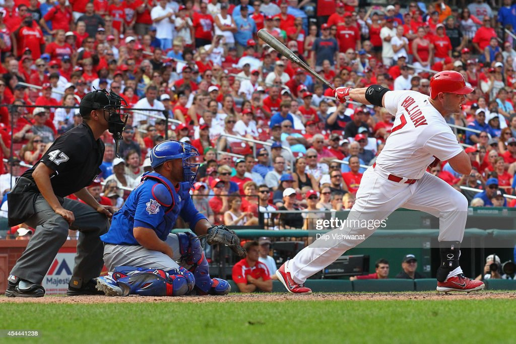 <a gi-track='captionPersonalityLinkClicked' href=/galleries/search?phrase=Matt+Holliday&family=editorial&specificpeople=207017 ng-click='$event.stopPropagation()'>Matt Holliday</a> #7 of the St. Louis Cardinals hits the game-winning, two-run single in the eighth inning against the Chicago Cubs at Busch Stadium on August 31, 2014 in St. Louis, Missouri. The Cardinals beat the Cubs 9-6.