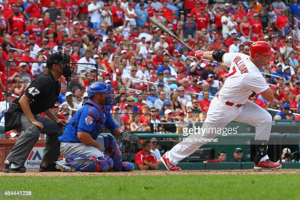 Matt Holliday of the St Louis Cardinals hits the gamewinning tworun single in the eighth inning against the Chicago Cubs at Busch Stadium on August...