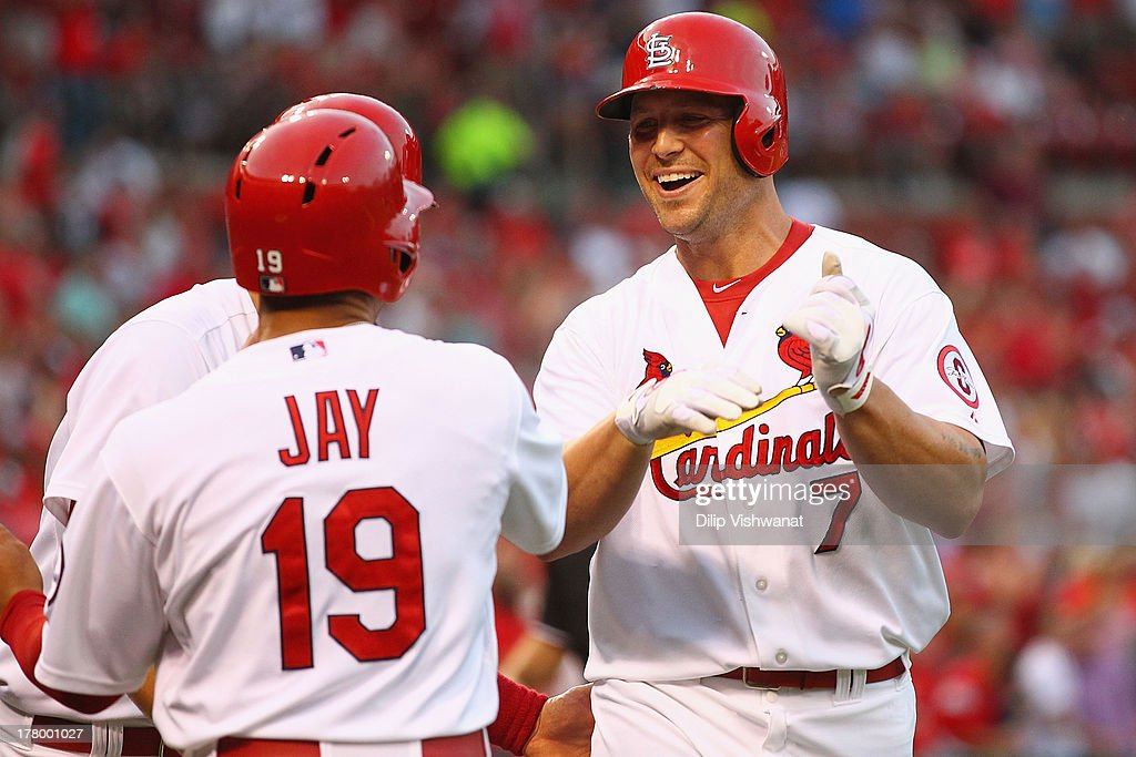 <a gi-track='captionPersonalityLinkClicked' href=/galleries/search?phrase=Matt+Holliday&family=editorial&specificpeople=207017 ng-click='$event.stopPropagation()'>Matt Holliday</a> #7 of the St. Louis Cardinals is congratulated by his teammates after hitting a three-run home run against starter Mike Leake #44 of the Cincinnati Reds in the third inning at Busch Stadium on August 26, 2013 in St. Louis, Missouri.