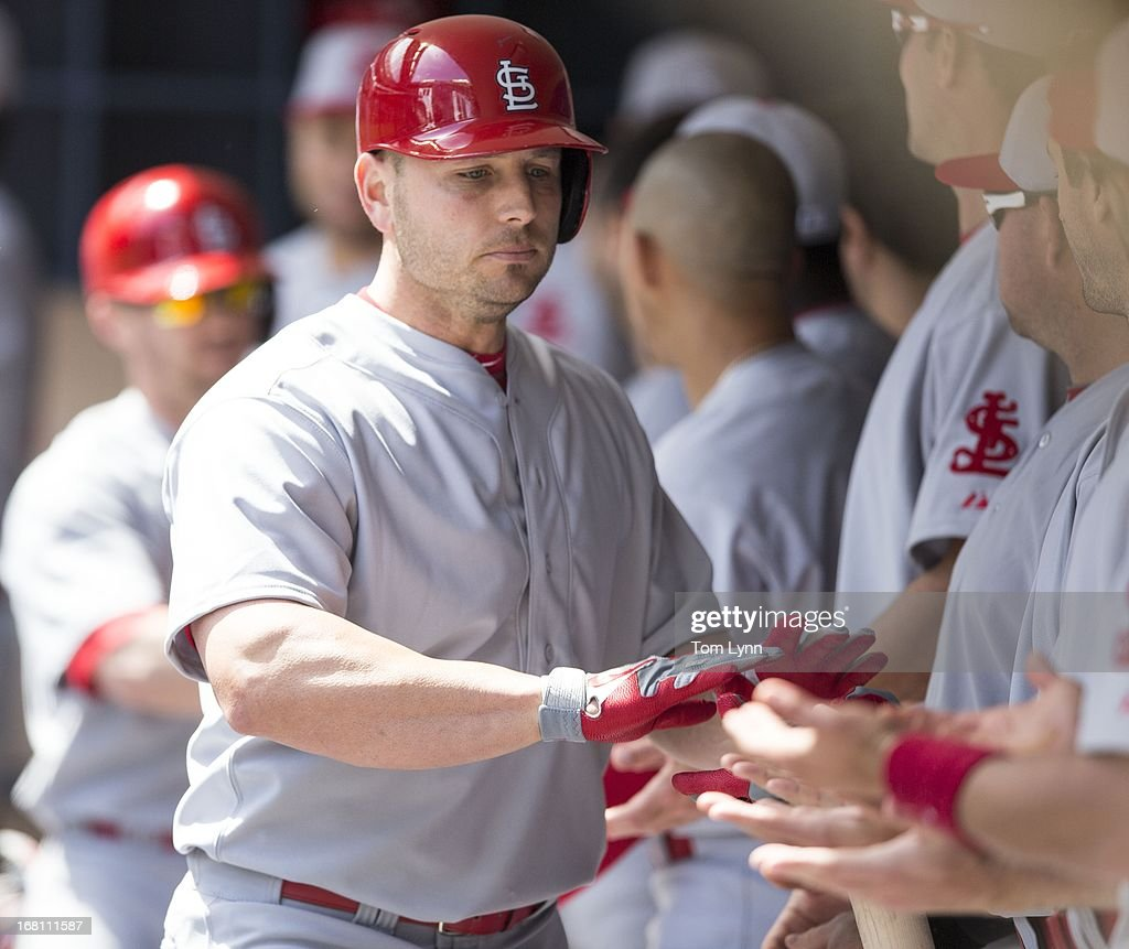 <a gi-track='captionPersonalityLinkClicked' href=/galleries/search?phrase=Matt+Holliday&family=editorial&specificpeople=207017 ng-click='$event.stopPropagation()'>Matt Holliday</a> #7 of the St Louis Cardinals is greeted by his teammates after hitting a two RBI home run off of Marco Estrada during the fourth inning at Miller Park on May 5, 2013 in Milwaukee, Wisconsin.