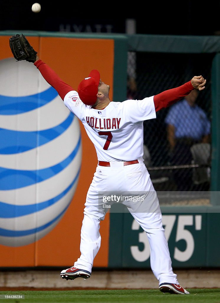Matt Holliday #7 of the St. Louis Cardinals makes a catch over his head on a ball hit by Brandon Belt #9 of the San Francisco Giants in the eighth inning in Game Five of the National League Championship Series at Busch Stadium on October 19, 2012 in St Louis, Missouri.