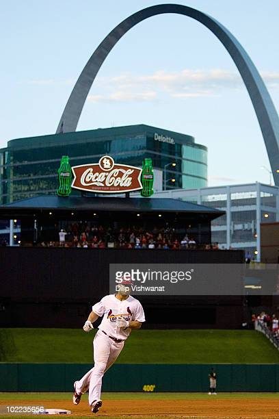Matt Holliday of the St Louis Cardinals rounds the bases after hitting a tworun home run against the Oakland Athletics at Busch Stadium on June 19...