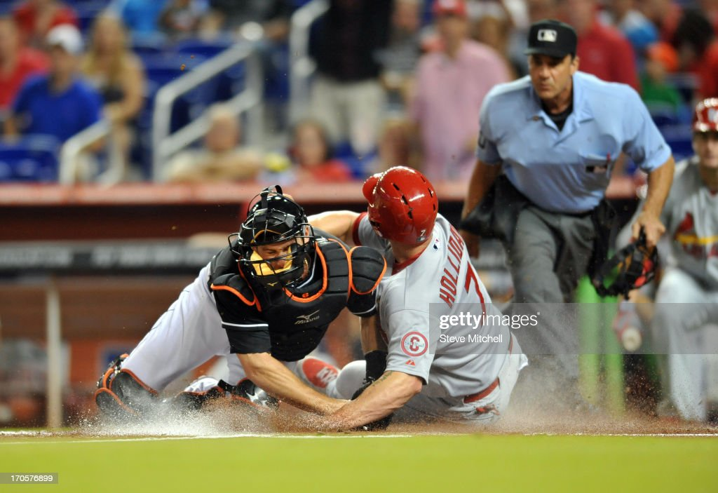 <a gi-track='captionPersonalityLinkClicked' href=/galleries/search?phrase=Matt+Holliday&family=editorial&specificpeople=207017 ng-click='$event.stopPropagation()'>Matt Holliday</a> #7 of the St. Louis Cardinals slides home safety as <a gi-track='captionPersonalityLinkClicked' href=/galleries/search?phrase=Jeff+Mathis&family=editorial&specificpeople=660661 ng-click='$event.stopPropagation()'>Jeff Mathis</a> #6 of the Miami Marlins is late on the tag during the first inning at Marlins Park on June 14, 2013 in Miami, Florida.