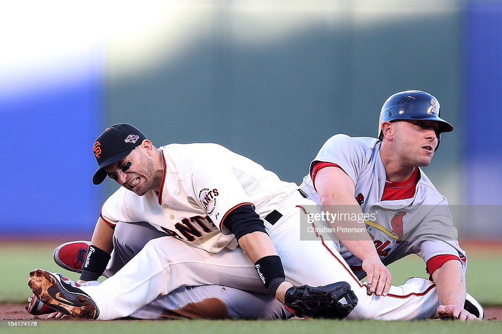 <a gi-track='captionPersonalityLinkClicked' href=/galleries/search?phrase=Matt+Holliday&family=editorial&specificpeople=207017 ng-click='$event.stopPropagation()'>Matt Holliday</a> #7 of the St. Louis Cardinals slides into second knocking over <a gi-track='captionPersonalityLinkClicked' href=/galleries/search?phrase=Marco+Scutaro&family=editorial&specificpeople=239523 ng-click='$event.stopPropagation()'>Marco Scutaro</a> #19 of the San Francisco Giants in the first inning of Game Two of the National League Championship Series at AT&T Park on October 15, 2012 in San Francisco, California.