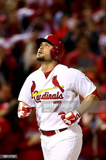 Matt Holliday of the St Louis Cardinals watches his solo home run in the fourth inning against the Boston Red Sox during Game Five of the 2013 World...