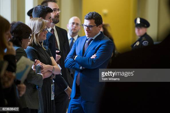 Matt House aide to Sen Charles Schumer DNY Senate minority leader for the 115th Congress talks with staff during the Senate Democratic Caucus...