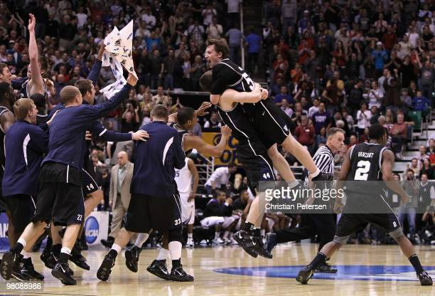 Matt Howard of the Butler Bulldogs leaps into the arms Andrew Smith as they celebrate defeating the Kansas State Wildcats in the west regional final...