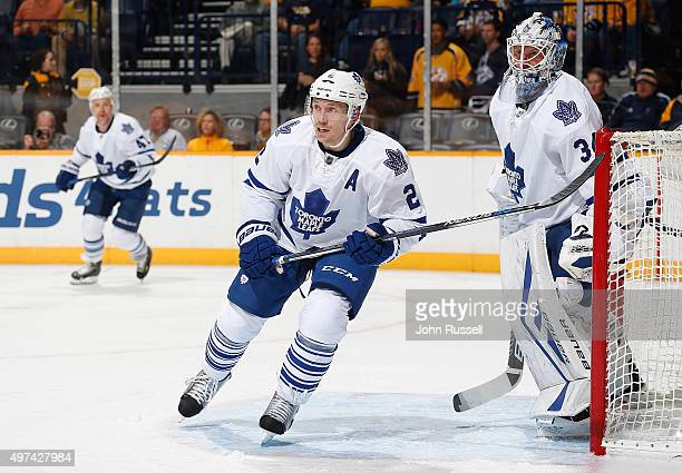 Matt Hunwick and James Reimer of the Toronto Maple Leafs eye the play against the Nashville Predators during an NHL game at Bridgestone Arena on...