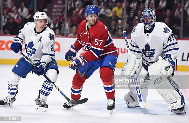 Matt Hunwick and Jonathan Bernier of the Toronto Maple Leafs defend the goal against Max Pacioretty of the Montreal Canadiens in the NHL game at the...