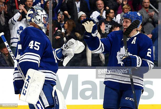 Matt Hunwick and Jonathan Bernier of the Toronto Maple Leafs celebrate the shutout win against the Los Angeles Kings during game action on December...