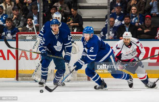Matt Hunwick and Nikita Zaitsev of the Toronto Maple Leafs skate against the Washington Capitals during the third period at the Air Canada Centre on...