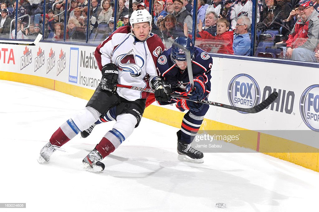 <a gi-track='captionPersonalityLinkClicked' href=/galleries/search?phrase=Matt+Hunwick&family=editorial&specificpeople=2284766 ng-click='$event.stopPropagation()'>Matt Hunwick</a> #22 of the Colorado Avalanche checks <a gi-track='captionPersonalityLinkClicked' href=/galleries/search?phrase=Tim+Erixon+-+Ice+Hockey+Player&family=editorial&specificpeople=8546945 ng-click='$event.stopPropagation()'>Tim Erixon</a> #20 of the Columbus Blue Jackets in the third period on March 3, 2013 at Nationwide Arena in Columbus, Ohio. Columbus defeated Colorado 2-1 in overtime.