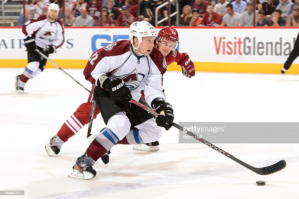 <a gi-track='captionPersonalityLinkClicked' href=/galleries/search?phrase=Matt+Hunwick&family=editorial&specificpeople=2284766 ng-click='$event.stopPropagation()'>Matt Hunwick</a> #22 of the Colorado Avalanche skates with the puck around <a gi-track='captionPersonalityLinkClicked' href=/galleries/search?phrase=Antoine+Vermette&family=editorial&specificpeople=206302 ng-click='$event.stopPropagation()'>Antoine Vermette</a> #50 of the Phoenix Coyotes during the first period at Jobing.com Arena on April 6, 2013 in Glendale, Arizona.