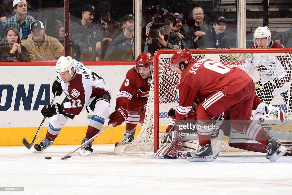 <a gi-track='captionPersonalityLinkClicked' href=/galleries/search?phrase=Matt+Hunwick&family=editorial&specificpeople=2284766 ng-click='$event.stopPropagation()'>Matt Hunwick</a> #22 of the Colorado Avalanche skates with the puck behind the net as <a gi-track='captionPersonalityLinkClicked' href=/galleries/search?phrase=Keith+Yandle&family=editorial&specificpeople=606912 ng-click='$event.stopPropagation()'>Keith Yandle</a> #3 and <a gi-track='captionPersonalityLinkClicked' href=/galleries/search?phrase=David+Schlemko&family=editorial&specificpeople=3144738 ng-click='$event.stopPropagation()'>David Schlemko</a> #6 of the Phoenix Coyotes defend during the second period at Jobing.com Arena on April 6, 2013 in Glendale, Arizona.