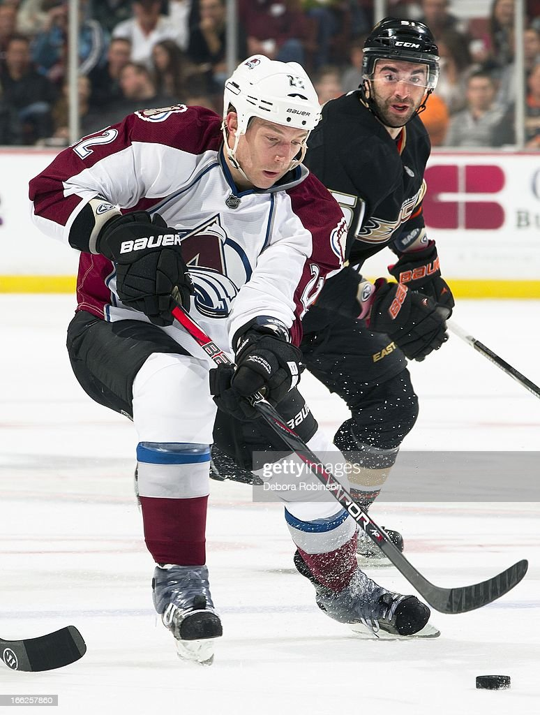 Matt Hunwick #22 of the Colorado Avalanche works to control the puck at center ice against Kyle Palmieri #51 of the Anaheim Ducks April 10, 2013 at Honda Center in Anaheim, California.