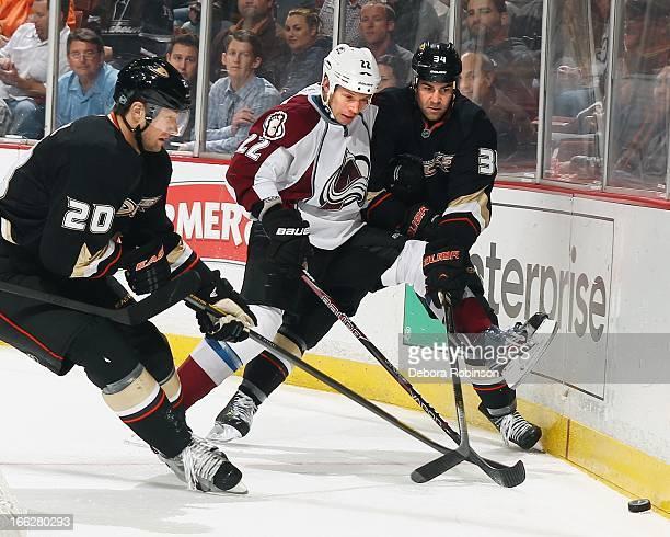 Matt Hunwick of the Colorado Avalanche works to get the puck past David Steckel and Daniel Winnik of the Anaheim Ducks April 10 2013 at Honda Center...