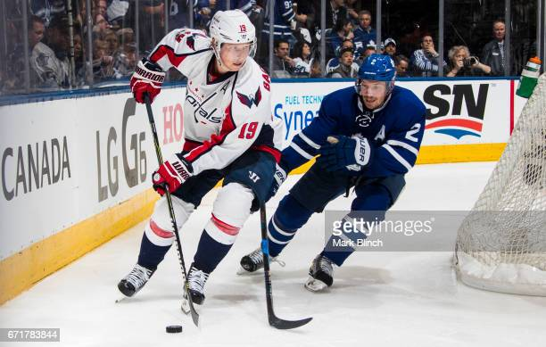 Matt Hunwick of the Toronto Maple Leafs battles with Nicklas Backstrom of the Washington Capitals during the second period in Game Four of the...