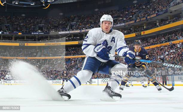 Matt Hunwick of the Toronto Maple Leafs defends against the Buffalo Sabres during an NHL game at the KeyBank Center on April 3 2017 in Buffalo New...