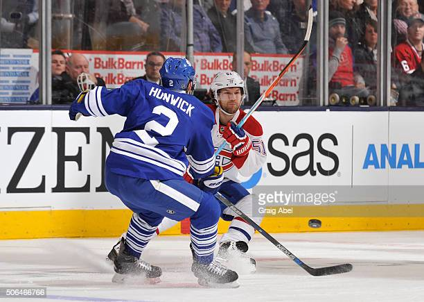 Matt Hunwick of the Toronto Maple Leafs defends as David Desharnais of the Montreal Canadiens passes the puck during NHL game action January 23 2016...
