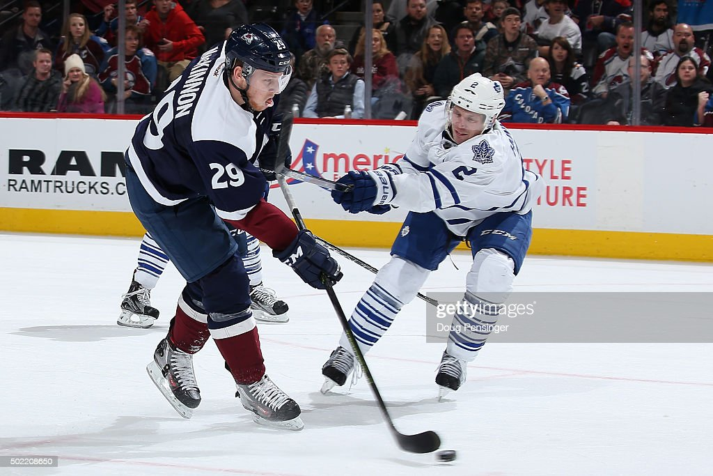 <a gi-track='captionPersonalityLinkClicked' href=/galleries/search?phrase=Matt+Hunwick&family=editorial&specificpeople=2284766 ng-click='$event.stopPropagation()'>Matt Hunwick</a> #2 of the Toronto Maple Leafs draws a penalty for slashing against <a gi-track='captionPersonalityLinkClicked' href=/galleries/search?phrase=Nathan+MacKinnon&family=editorial&specificpeople=8610127 ng-click='$event.stopPropagation()'>Nathan MacKinnon</a> #29 of the Colorado Avalanche at Pepsi Center on December 21, 2015 in Denver, Colorado. The penalty lead to a powerplay goal by Erik Johnson #6 of the Colorado Avalanche to tie the score 3-3 in the second period.