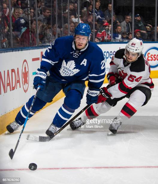 Matt Hunwick of the Toronto Maple Leafs skates against Joseph Blandisi of the New Jersey Devils during the second period at the Air Canada Centre on...