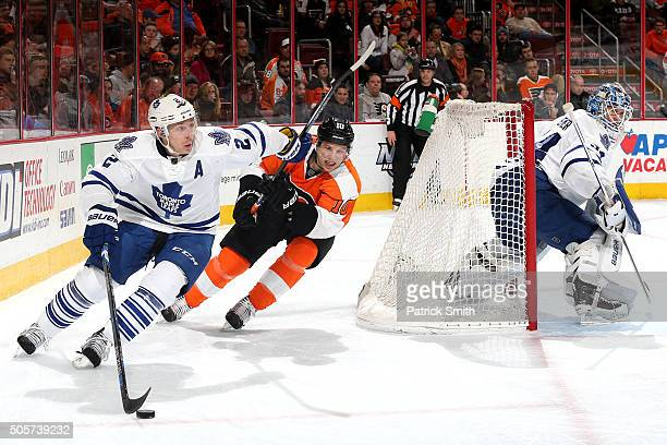 Matt Hunwick of the Toronto Maple Leafs skates past Brayden Schenn of the Philadelphia Flyers during the second period at Wells Fargo Center on...