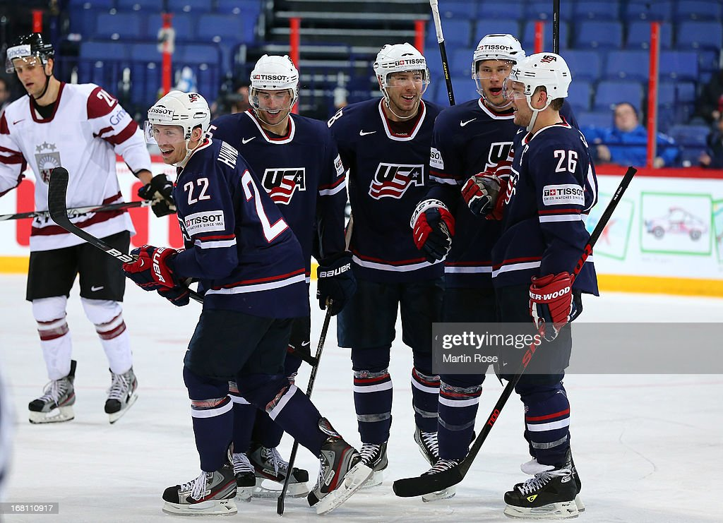 <a gi-track='captionPersonalityLinkClicked' href=/galleries/search?phrase=Matt+Hunwick&family=editorial&specificpeople=2284766 ng-click='$event.stopPropagation()'>Matt Hunwick</a> (#22) of USA celebrate with hist team mates after he scores his team's 4th goal during the IIHF World Championship group H match between Latvia and USA at Hartwall Areena on May 5, 2013 in Helsinki, Finland.
