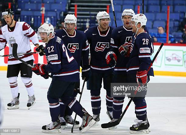 Matt Hunwick of USA celebrate with hist team mates after he scores his team's 4th goal during the IIHF World Championship group H match between...
