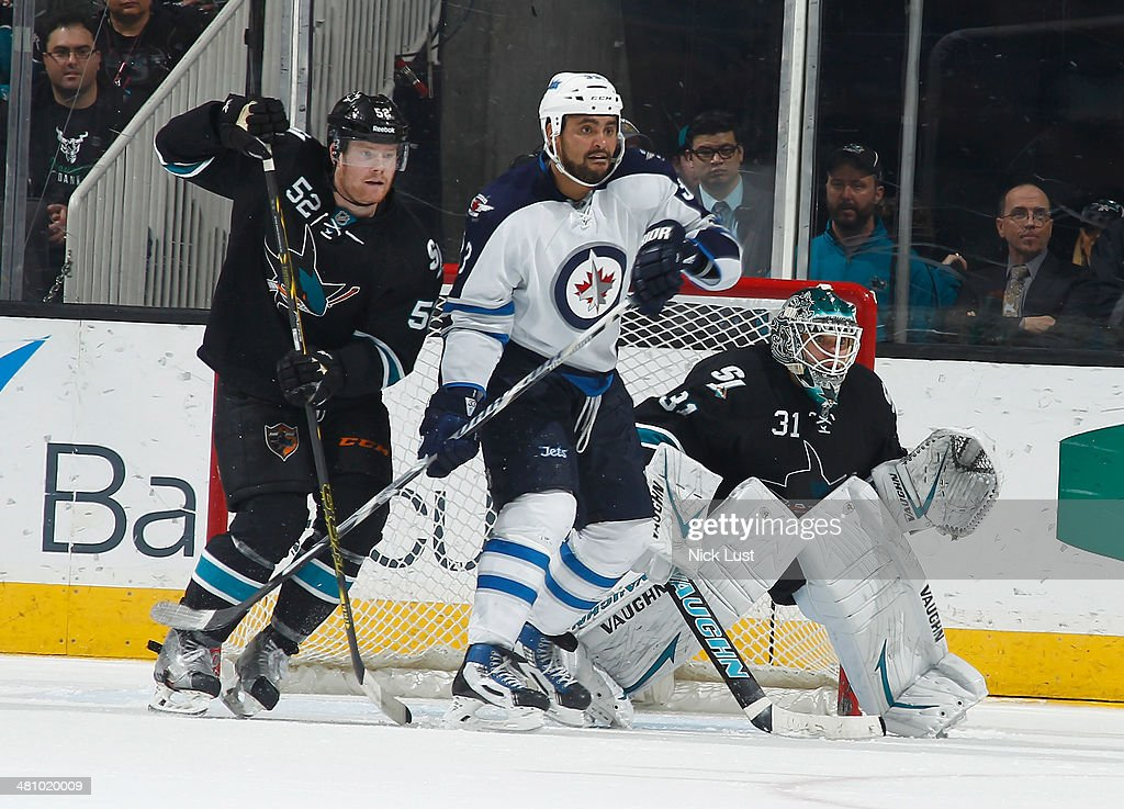 Matt Irwin #52 and Antti Niemi #31 of the San Jose Sharks protect the net against Dustin Byfuglien #33 of the Winnipeg Jets during an NHL game on March 27, 2014 at SAP Center in San Jose, California.