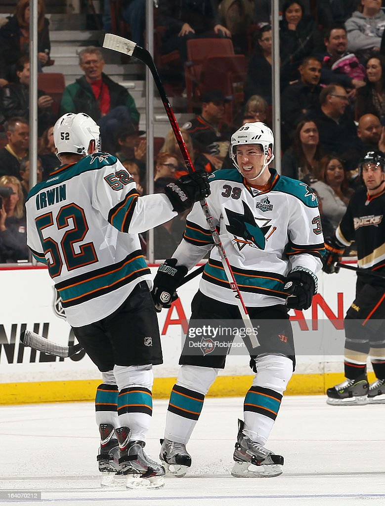 Matt Irwin #52 and Logan Couture #39 of the San Jose Sharks celebrate Irwin's third period goal scored during the game against the Anaheim Ducks on March 18, 2013 at Honda Center in Anaheim, California.