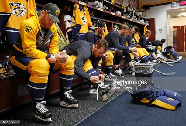 Matt Irwin and Yannick Weber of the Nashville Predators prepare for an NHL game against the San Jose Sharks at Bridgestone Arena on March 25 2017 in...