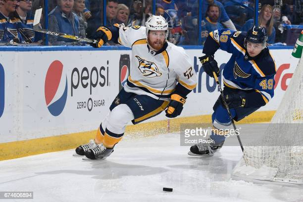 Matt Irwin of the Nashville Predators and Ivan Barbashev of the St Louis Blues race towards the puck in Game Two of the Western Conference Second...