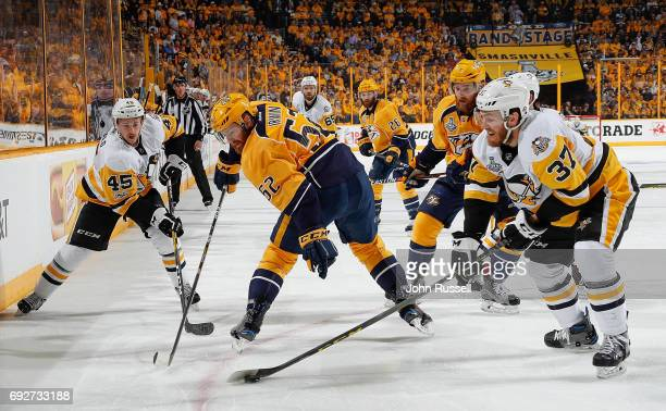 Matt Irwin of the Nashville Predators battles for the puck against Carter Rowney and Josh Archibald during Game Four of the 2017 NHL Stanley Cup...