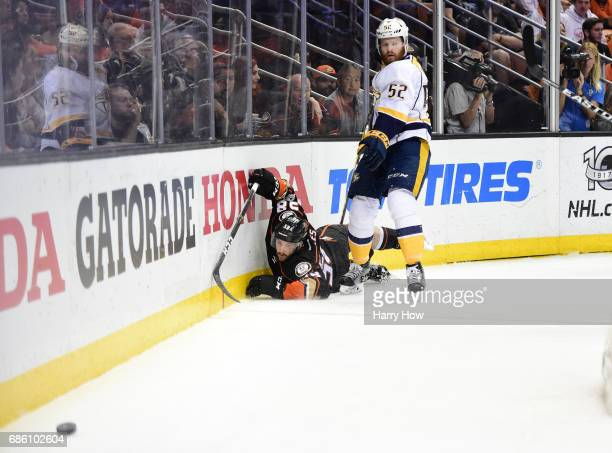 Matt Irwin of the Nashville Predators checks Nic Kerdiles of the Anaheim Ducks t the ice in the first period of Game Five of the Western Conference...