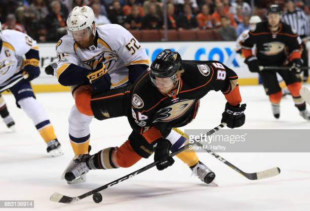 Matt Irwin of the Nashville Predators trips Ondrej Kase of the Anaheim Ducks in the first period of Game Two of the Western Conference Final during...