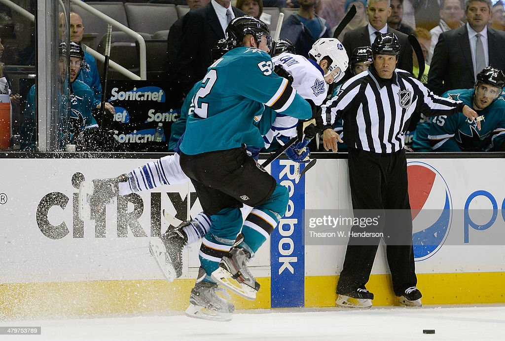 Matt Irwin #52 of the San Jose Sharks collides with <a gi-track='captionPersonalityLinkClicked' href=/galleries/search?phrase=Nazem+Kadri&family=editorial&specificpeople=4043234 ng-click='$event.stopPropagation()'>Nazem Kadri</a> #43 of the Toronto Maple Leafs during the third period at SAP Center on March 11, 2014 in San Jose, California. The Sharks won the game 6-2.