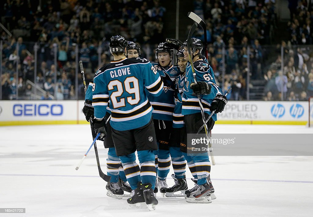 Matt Irwin #52 of the San Jose Sharks is congratulated by teammates after he scored against the St. Louis Blues at HP Pavilion on March 9, 2013 in San Jose, California.