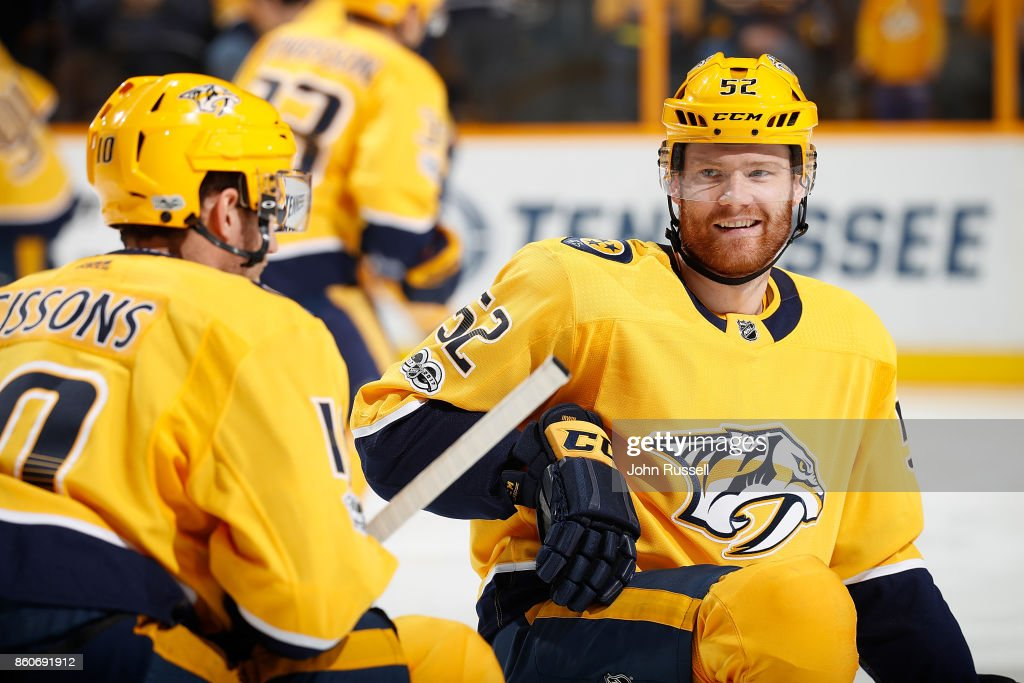 Matt Irwin #52 stretches with Colton Sissons #10 of the Nashville Predators in warmups prior to an NHL game against the Dallas Stars at Bridgestone Arena on October 12, 2017 in Nashville, Tennessee.