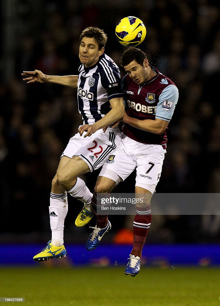 Matt Jarvis of West Ham battles in the air with <a gi-track='captionPersonalityLinkClicked' href=/galleries/search?phrase=Zoltan+Gera&family=editorial&specificpeople=216370 ng-click='$event.stopPropagation()'>Zoltan Gera</a> of West Brom during the Barclays Premier League match between West Bromwich Albion and West Ham United at the Hawthorns on December 16, 2012 in West Bromwich, England.