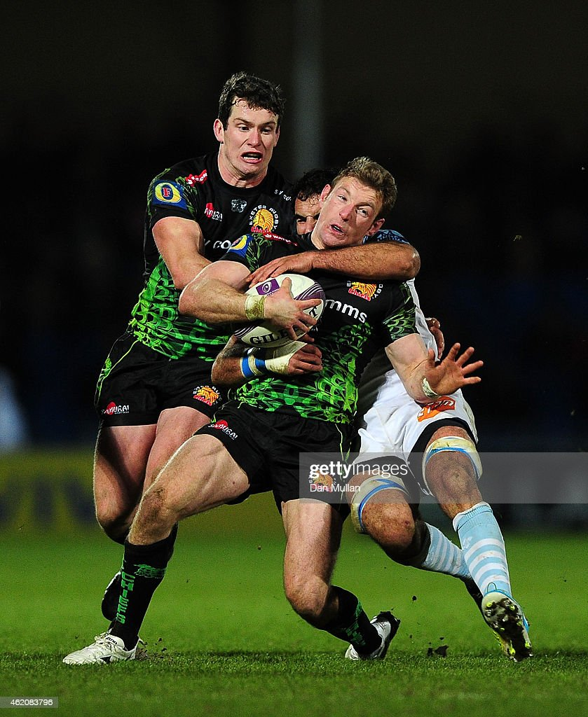 Matt Jess of Exeter Chiefs is tackled by JeanJo Marmouyet of Bayonne during the European Rugby Challenge Cup match between Exeter Chiefs and Bayonne...